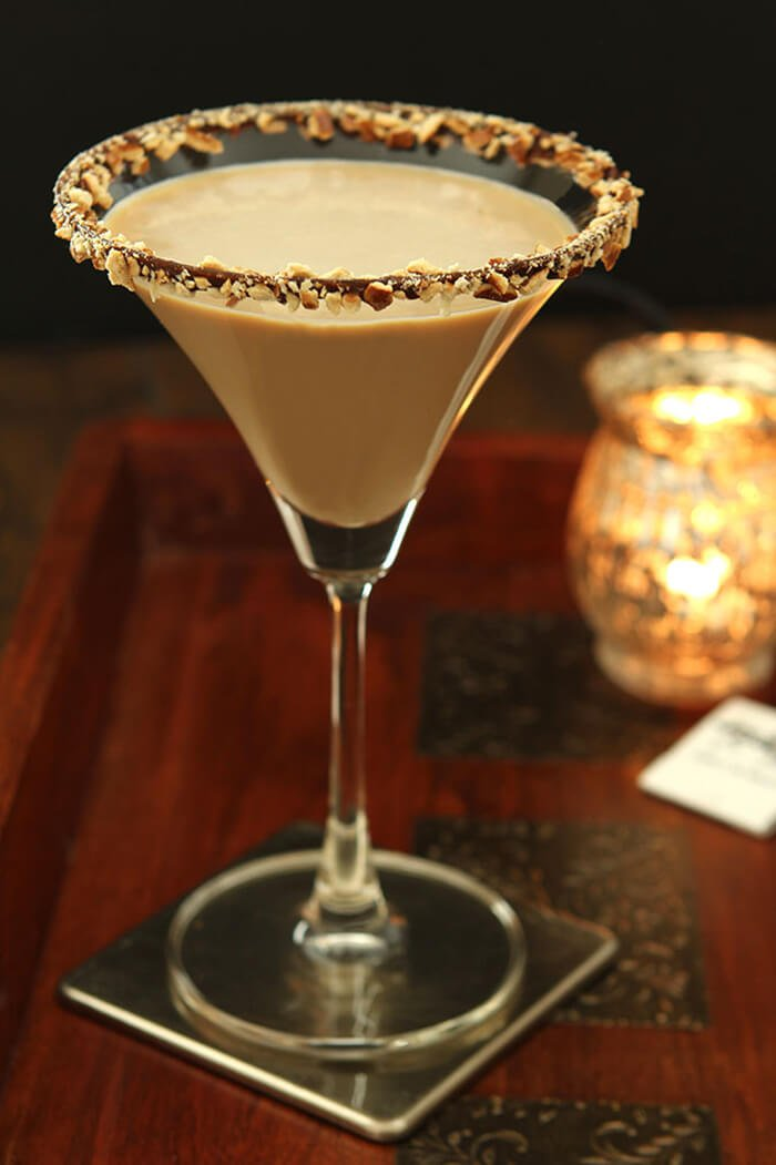 Closup of Salted Caramel Espresso Martini Cocktail with a Chocolate and Pretzel Rim