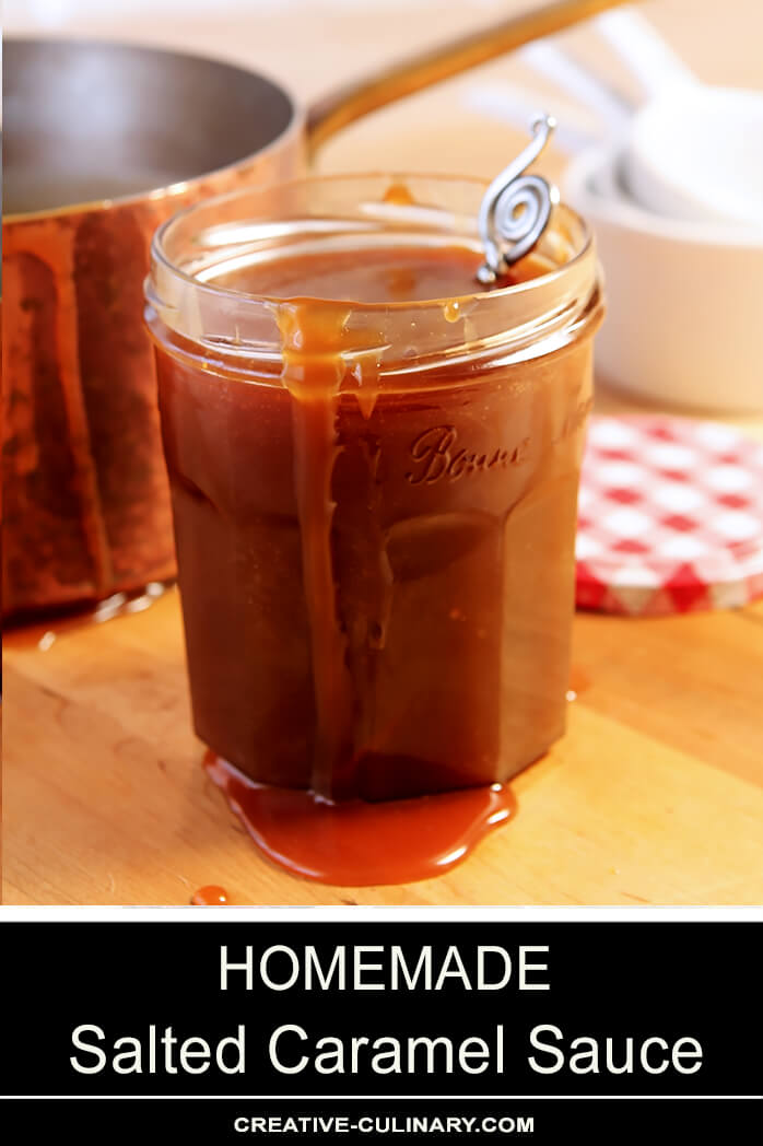 Homemade Salted Caramel Sauce in Jar with Serving Spoon