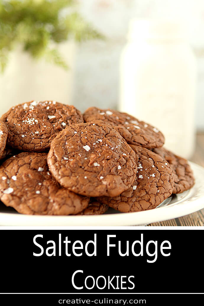 Salted Fudge Cookies Stacked on a White Plate