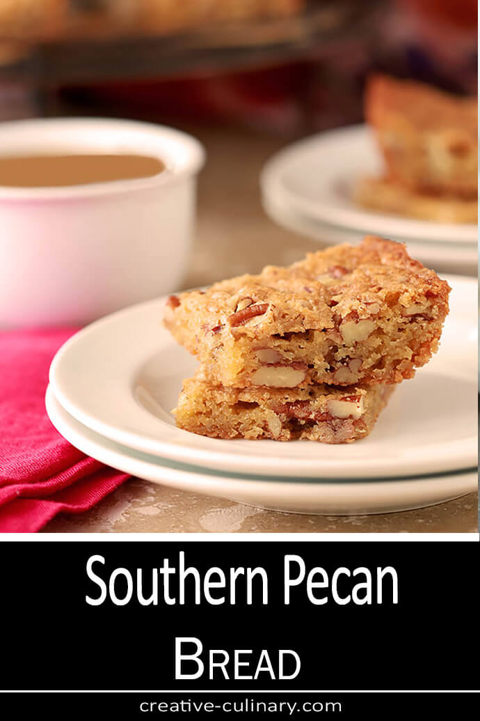 Southern Pecan Bread slices served on a white plate with a cup of coffee.