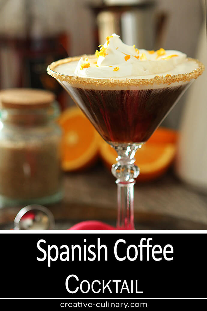 Spanish Coffee with Brandy topped with whipped cream and orange zest.