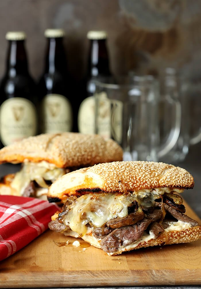 Steak and Cheese Sandwich with Caramelized Onions and Mushrooms Served on a Sesame Seed Roll