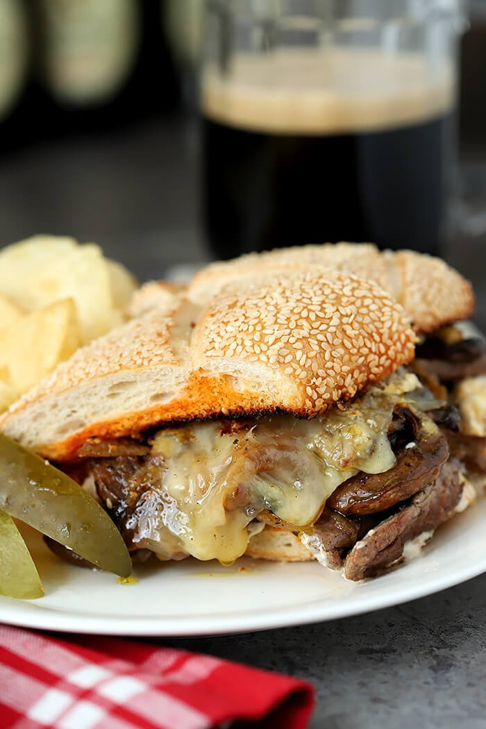 Closeup of Steak and Cheese Sandwich with Caramelized Onions and Mushrooms