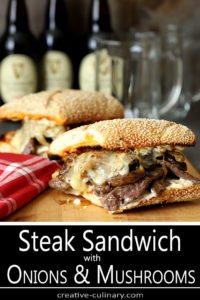 Two Steak and Cheese Sandwiches with Caramelized Onions and Mushrooms on a Cutting Board