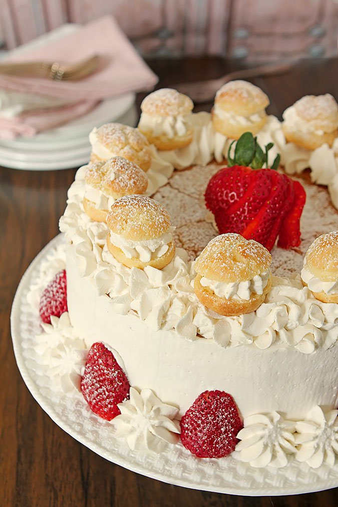 Strawberry Cream Puff Cake With Fresh Strawberries and Small Cream Puffs for Decoration
