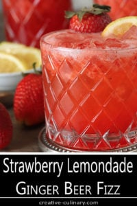 Closeup of Strawberry Lemonade Ginger Beer Fizz Garnished with Lemon and Strawberry