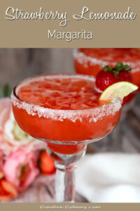 Strawberry Lemonade Margarita Garnished with a Strawberry and Lime Wedge