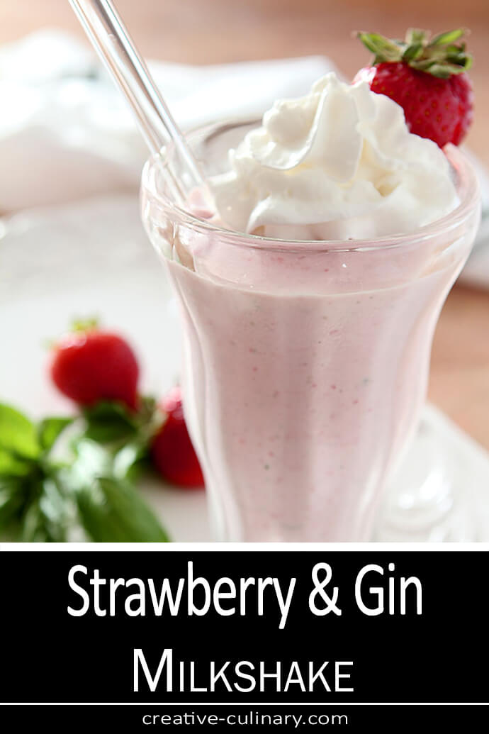 Strawberry and Gin Milkshake served in an old fashioned sundae glass; garnished with a strawberry.