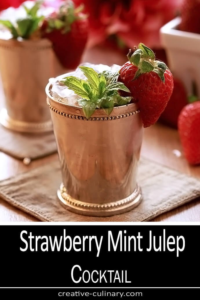 Strawberry Mint Julep Cocktail in a Silver Julep Cup with Mint and Strawberry Garnish