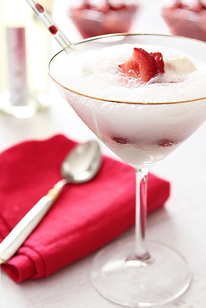 Strawberry Prosecco Float Cocktail served in a champagne glass with a straw.