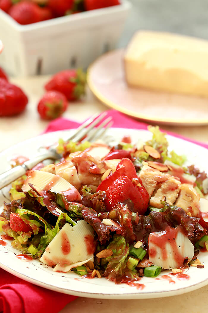 Strawberry Sky Salad Dressing on a Strawberry and Chicken Salad Served on a White Plate with Cheese