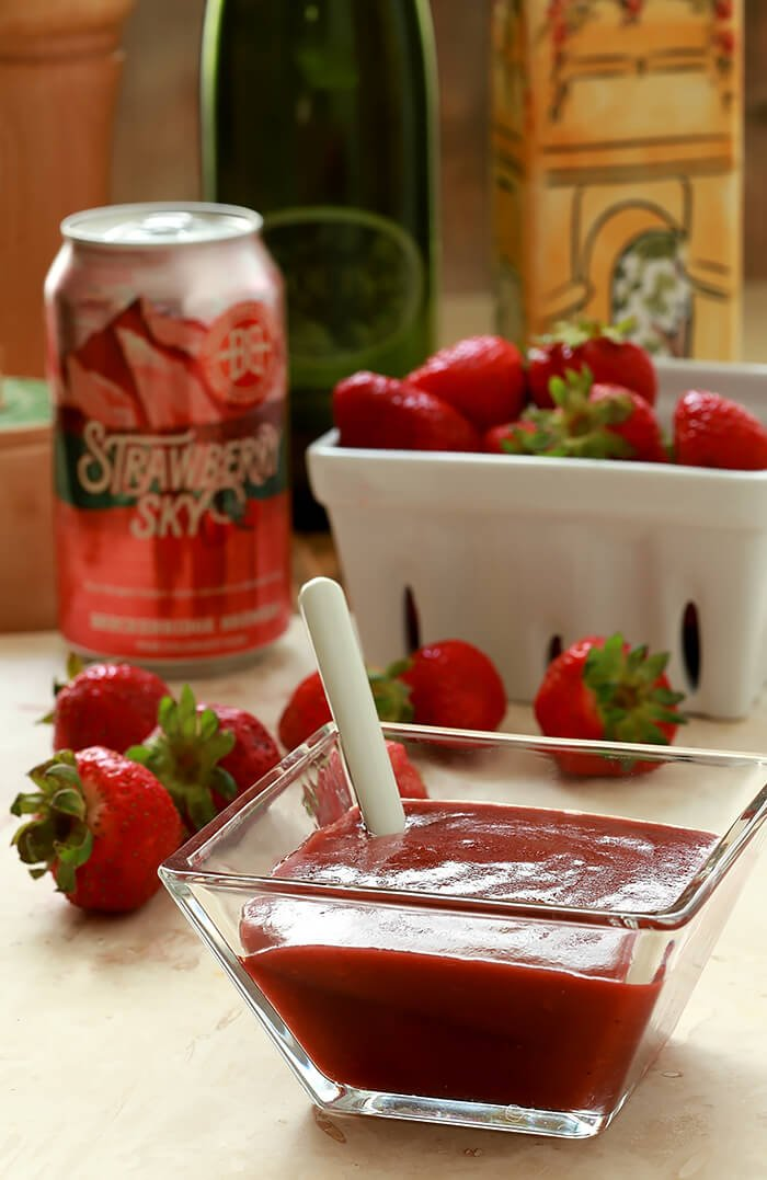 Strawberry Sky Salad Dressing in a Glass Serving Container with Can of Strawberry Sky Beer