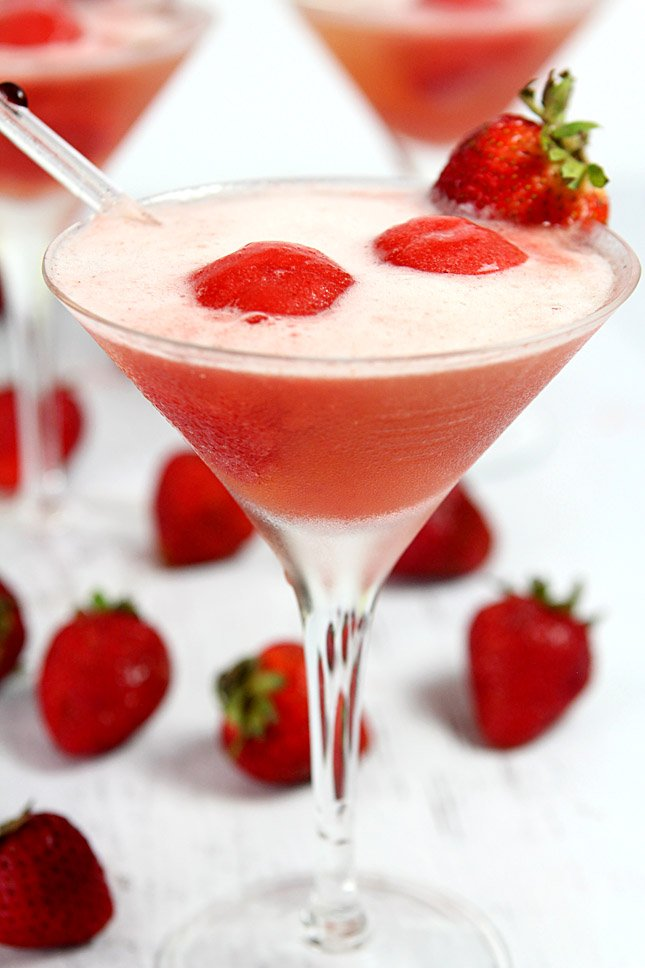 Sparkling Strawberry Sorbet Cocktail combines homemade sherbet with chilled prosecco in a martini glass.