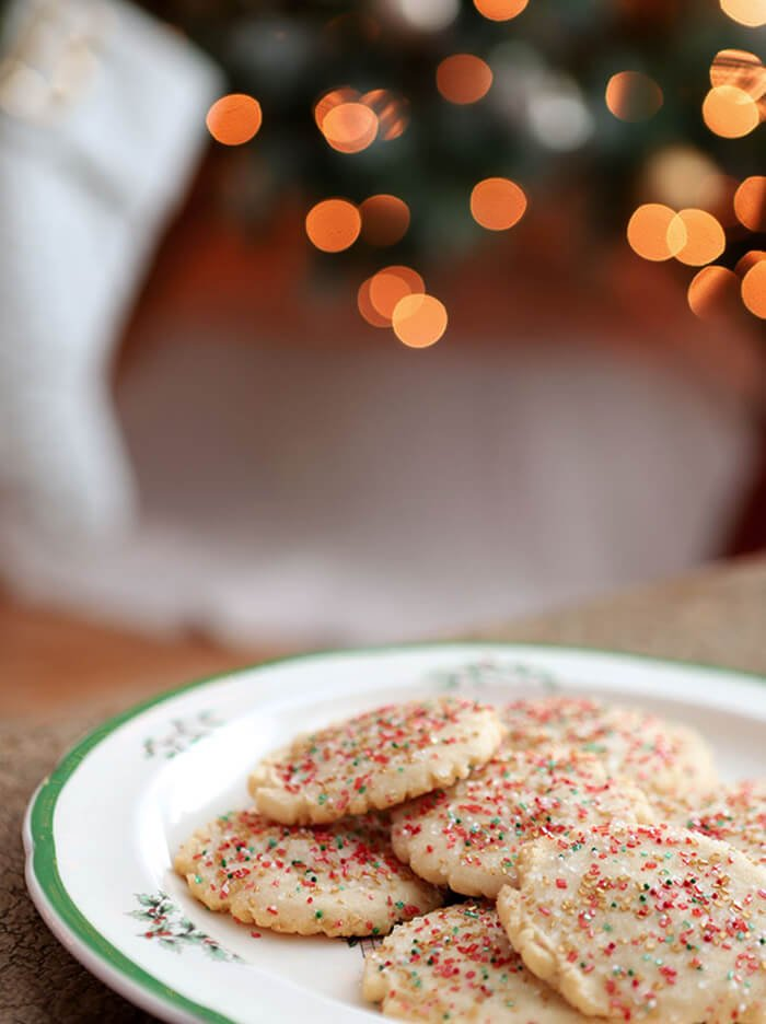 Amish Sugar Cookies Decorated with Red, Green, and Gold Sugar Crystals for Christmas