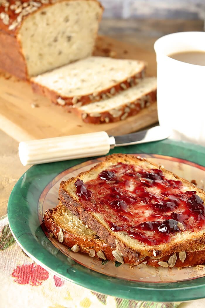 Buttered Slices of Sunflower Seed Bread with Cherry Jam