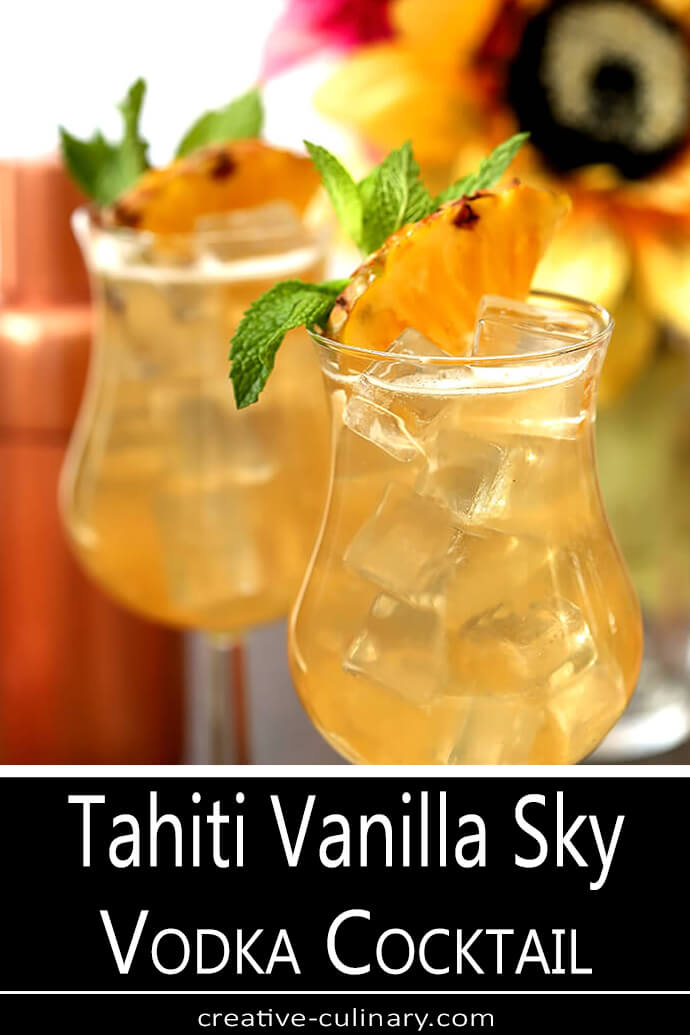 Tahiti Vanilla Sky Vodka Cocktails with Copper Shaker and Island Tropical Flowers in Yellow and Pink