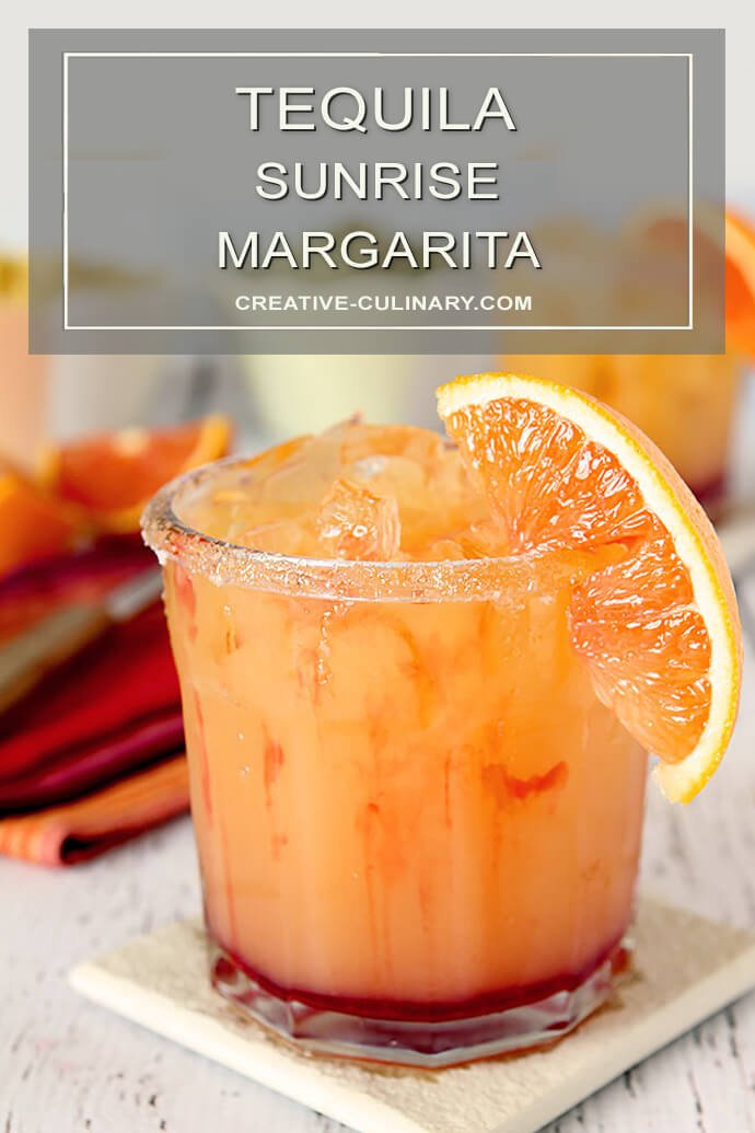 Tequila Sunrise Margarita with a Sugar Rim Garnish and Orange Section.