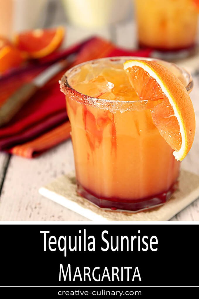 Tequila Sunrise Margarita in a Glass with Orange Segment Garnish