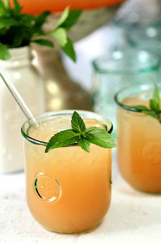 Mint Garnishes a Glass of Bourbon Punch with Pink Grapefruit