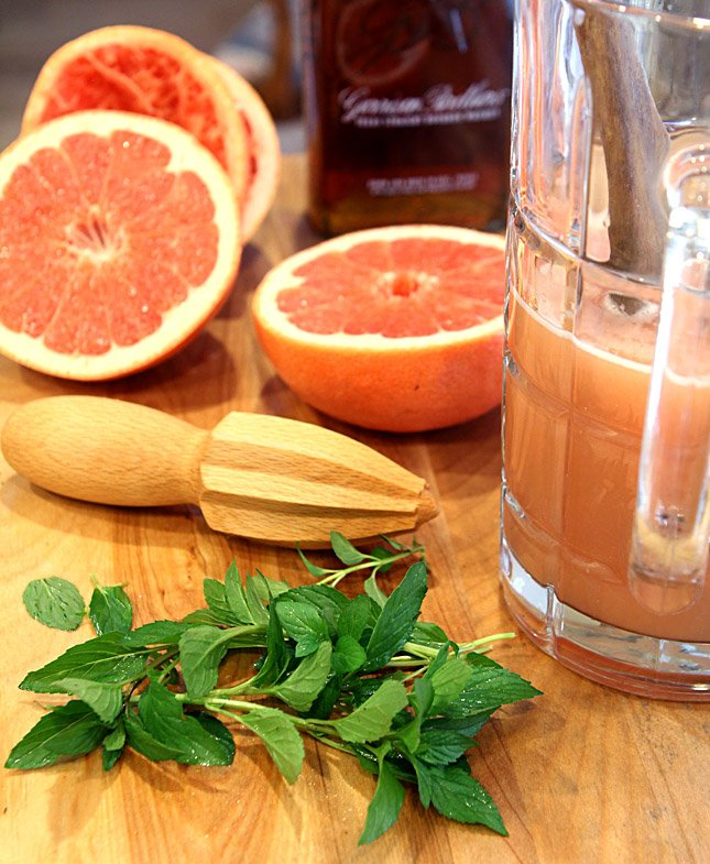 Bourbon Punch with Pink Grapefruit Ingredients including Fresh Grapefruit, Mint, and Texas Bourbon