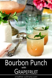 Grapefruit Punch with Bourbon in Glasses with Mint Garnish