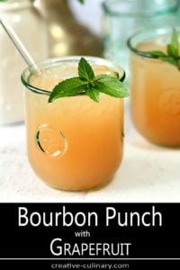 Bourbon Punch with Grapefruit Garnished with Mint Sprig