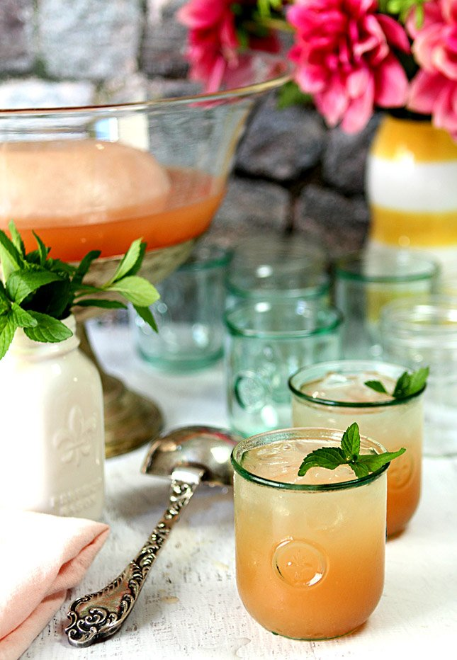 Bourbon Punch with Pink Grapefruit Served in Short Glasses with Mint Garnish