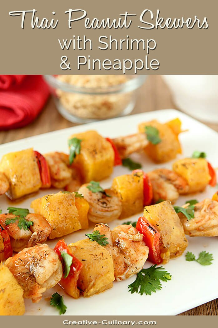 Thai Peanut Skewers with Shrimp and Pineapple on a White Serving Plate