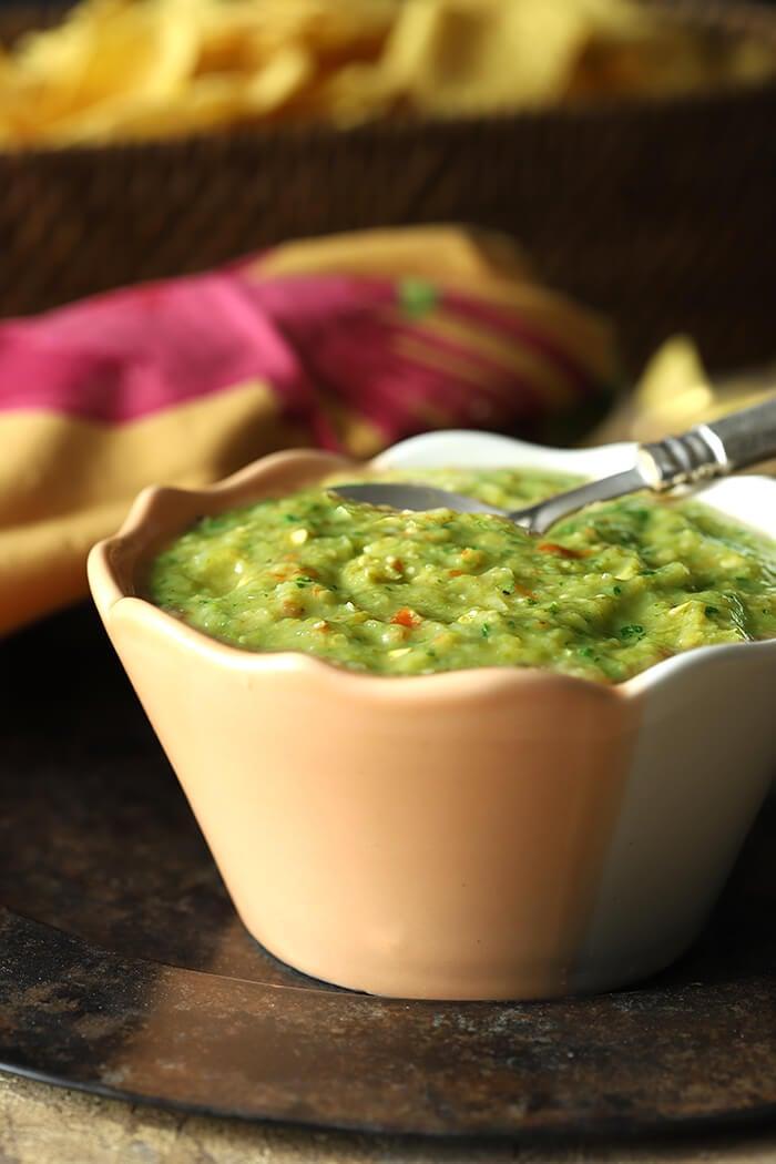 Tomatillo Salsa Verde (Green Salsa) in a Peach and White Bowl