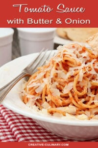 Tomato Sauce with Butter and Onion Served in a White Bowl and Parmesan Cheese