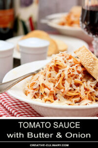 Tomato Sauce with Butter and Onion Served in a White Bowl and Parmesan Cheese and Italian Bread