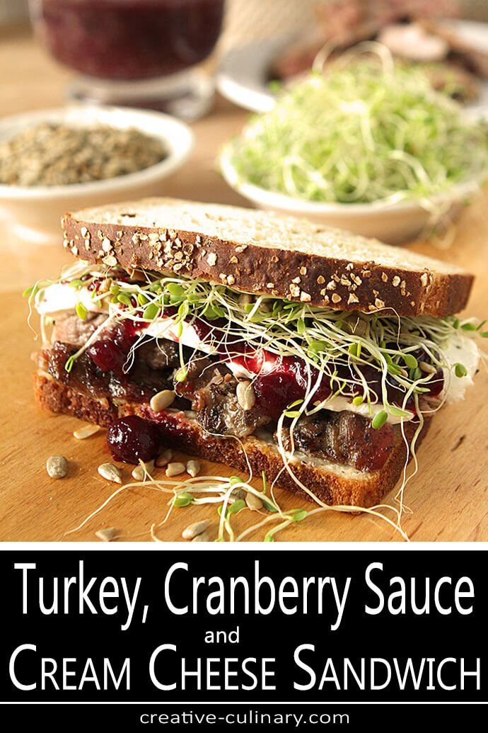Turkey Cranberry and Cream Cheese Sandwich with Sprouts and Sunflower Seeds on a Cutting Board