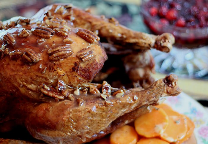 Fried Turkey with Honey, Bourbon, and Pecan Sauce Whole on a Platter with Carrots