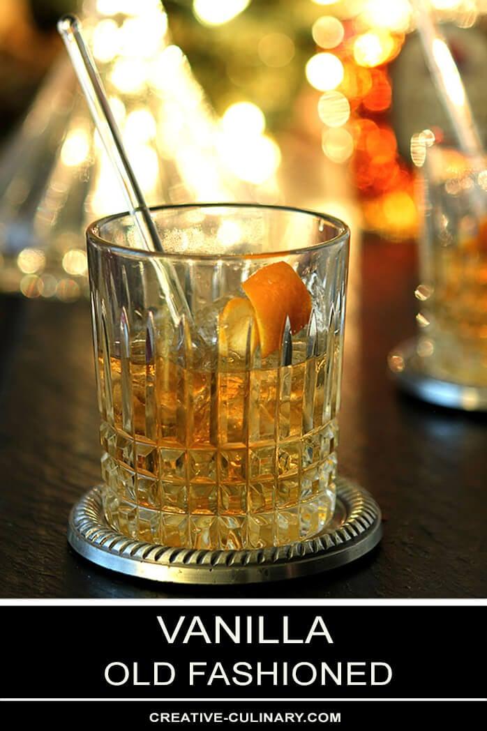 Vanilla Old Fashioned Cocktail with Glass Swizel Stick and Orange Peel Garnish