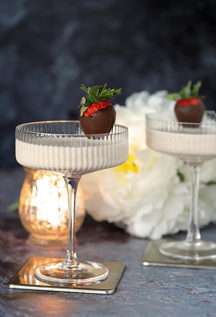 Disaranno Velvet White Espresso Martini Cocktail Garnished with Chocolate Covered Strawberry