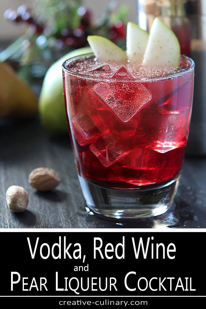 Vodka, Pear, and Red Wine Cocktail in a Lowball Glass with Pear and Nutmeg Garnish