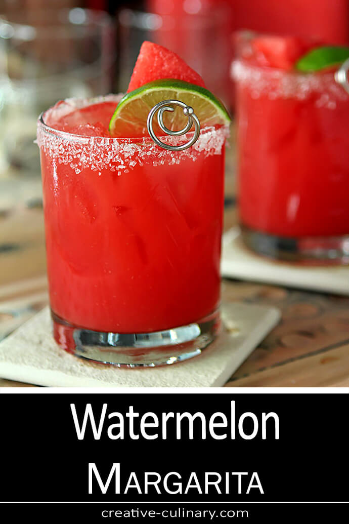 Watermelon Margarita Cocktail served in a lowball glass with a sugar/salt rim and lime garnish.