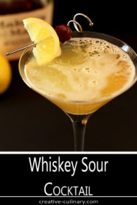 The Classic Whiskey Sour Cocktail is Garnished with Lemon and Cherry