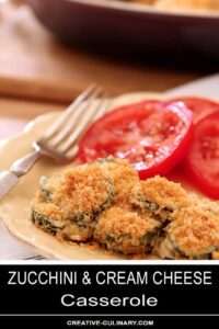 Serving of Zucchini and Cream Cheese Casserole with Sliced Garden Tomatoes